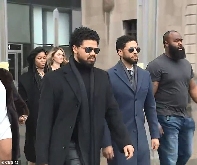 Smollett and his brother Jake leave the court with other members of their family behind them