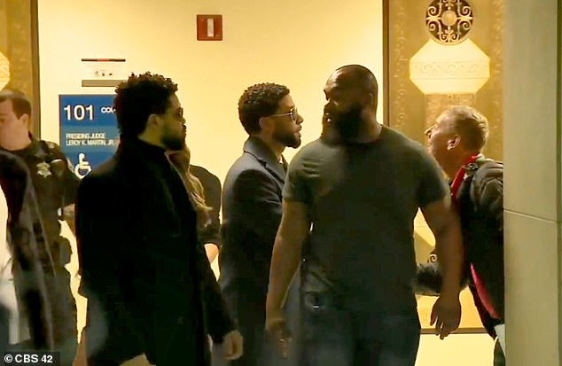 As he left the courtroom, Smollett stopped to shake hands with an unidentified man waiting outside
