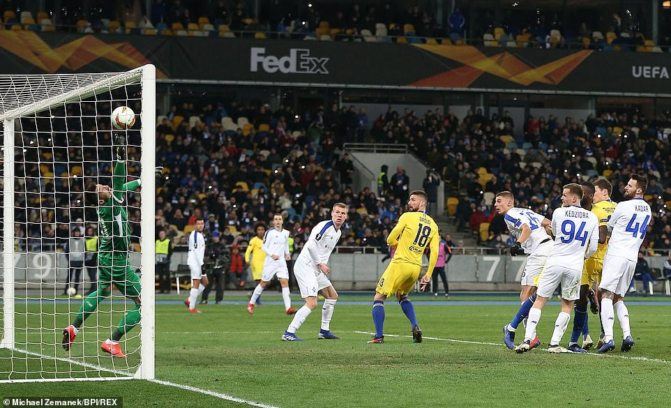 Olivier Giroud completes his hat-trick on the hour mark with a near-post flicked header from Willian's free-kick