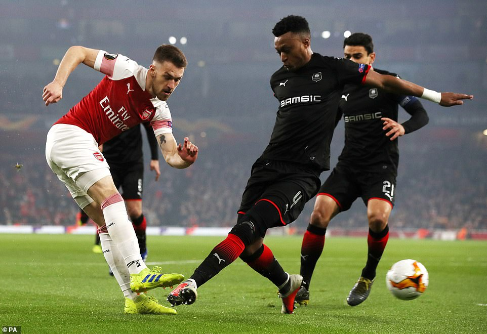 It was great work by Aaron Ramsey (left) who managed to squeeze in a low cross for his team-mate - despite Rennes pressure
