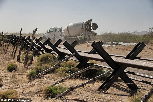 Customs and Border Protection says it has replaced 'dilapidated' border barriers that consisted of Normandy-style vehicle barriers like these, shown in April 2018 between Santa Teresa, New Mexico and Ciudad Mexico