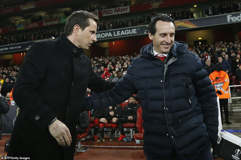 Arsenal manager Unai Emery (right) greets his Rennes counterpartJulien Stephan before kick-off