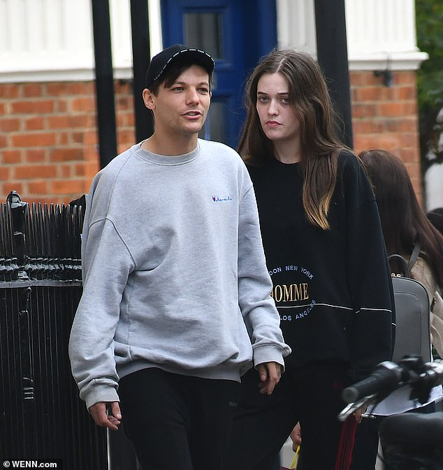Close: Louis has been left 'devastated' by the death of his sister, the Sun reported on Thursday, with the two regularly meeting up in London (pictured together in September 2018)