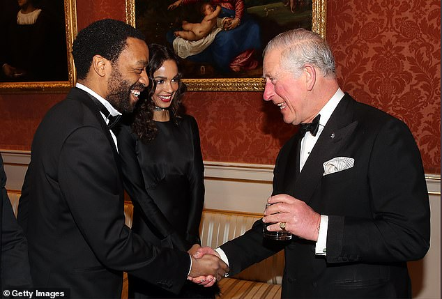 All smiles:Chiwetel Ejiofor shook hands with Prince Charles as the two chatted at the occasion