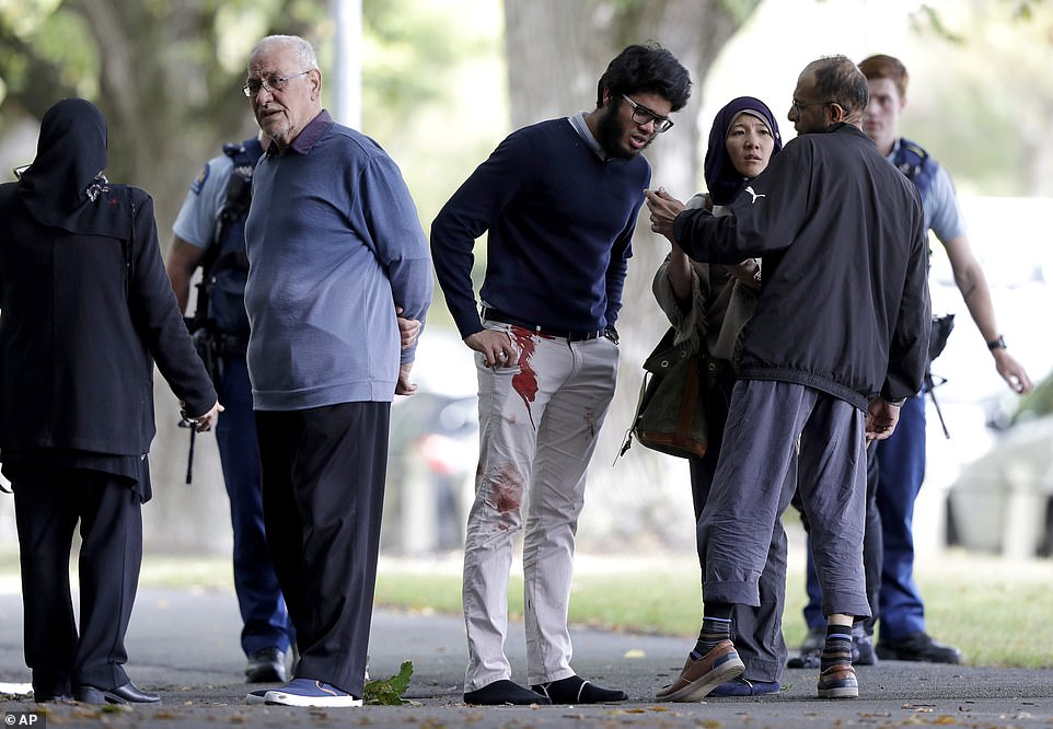 A man was seen with bloodstains on his trousers near the mosque after the shooting, as 48 people are left with gun wounds