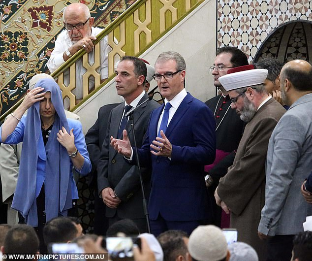 Leader of the Opposition Michael Daley (pictured middle) were among multiple politicians in attendance to pay their respect