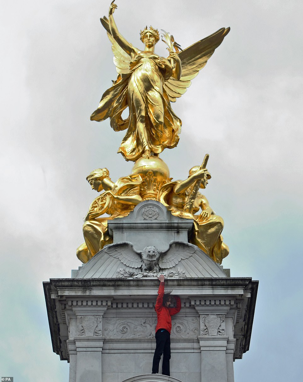The demonstration outside the Houses of Parliament soon marched the short walk to the Mall where they descended outside the gates of Buckingham Palace. One protester climbed up the Queen Victoria Memorial outside the palace