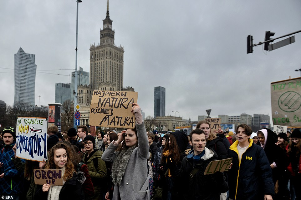 In Warsaw, Poland, more youngsters wave placards on the day of environmental action, dubbed#FridayForFuture