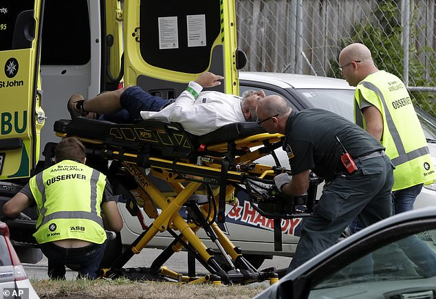 Ambulance staff rush to take a stricken man to the hospital after he was injured in the attack