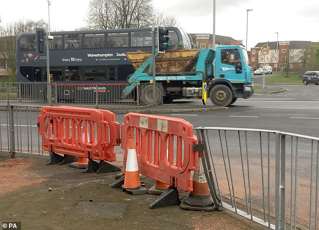 The scene of the fatal crash at the junction in Wolverhampton is pictured this morning