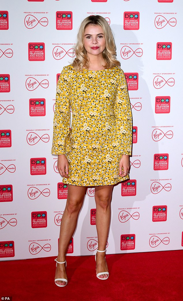 Standing tall: Jackson showed off her long, lean legs in a flirty yellow mini-dress while adding a pair of strappy white heels to her look