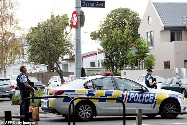 A total of 49 people have been reported dead after attacks at two mosques in Christchurch (pictured: police outside the Al Noor Mosque