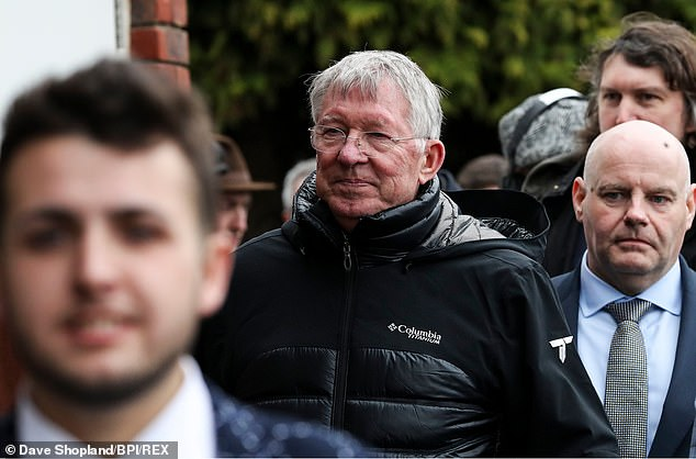 Ferguson was seen smiling as the Scot soaked up the atmosphere at the Cheltenham Festival