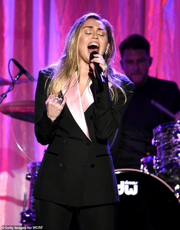 Happy:And the Wrecking Ball singer, 26, who is joining the likes of The Killers and The Cure, shared her excitement over performing at the elusive music event