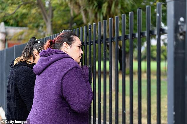 Parentsrefuse to leave without their children as their school, Te Waka Unua School, is in lockdown