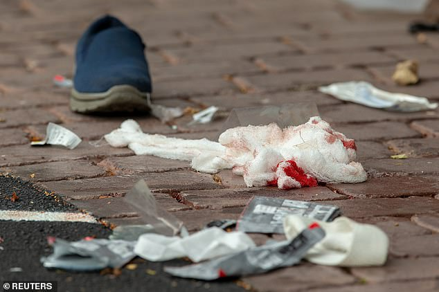 Pictured: Bloodied bandages on the road after the shooting at the Al Noor mosque in Christchurch