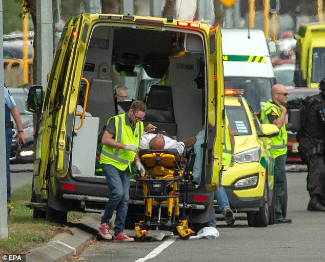 An injured person is loaded in an ambulance following a shooting resulting in multiple fatalies and injuries at the Masjid Al Noor on Deans Avenue in Christchurch