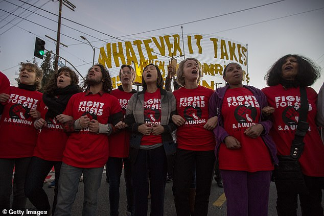 Striking McDonald's restaurant employees in an intersection before being arrested, after walking off the job to demand a $15 per hour wage and union rights during nationwide 'Fight for $15 Day of Disruption' protests on November 29, 2016 in Los Angeles, California