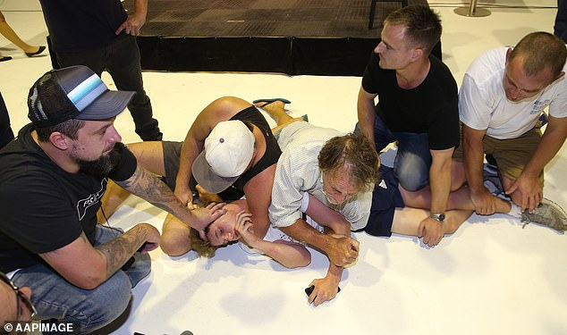 Attendees of the event held the young man on the ground after the physical altercation