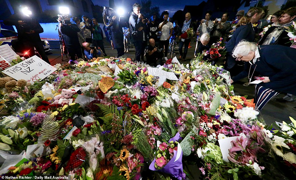 Notes left alongside floral tributes read 'This is not NZ' and 'we are one' and 'you are my friends, I will keep watch while you pray' as New Zealanders echoed their Prime Minister Jacinda Adhern. She said: 'These are people who I would describe as having extremist views that have absolutely no place in New Zealand and, in fact, have no place in the world'