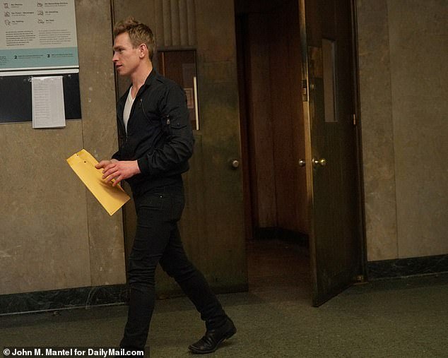 Nick Gruber, Calvin Klein's former porn star boyfriend is seen coming out of court on Friday