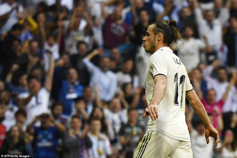 Bale celebrates after scoring Real Madrid's second goal of the game with 12 minutes remaining at the Bernabeu