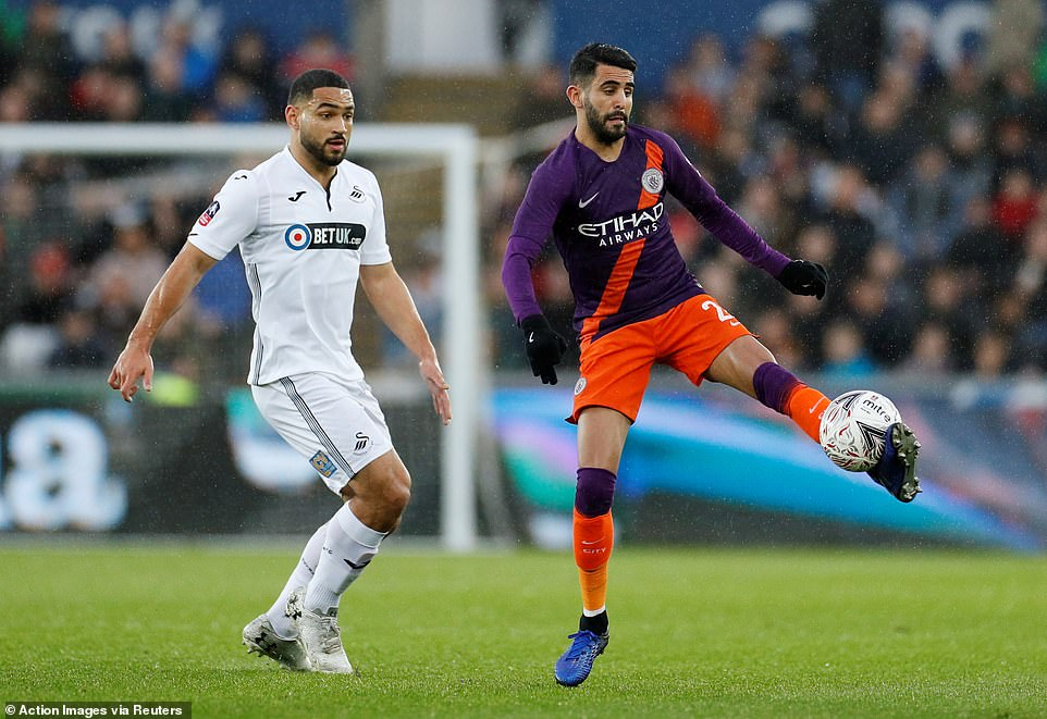 Manchester City's Riyad Mahrez controls the ball while under pressure from Swansea's Cameron Carter-Vickers