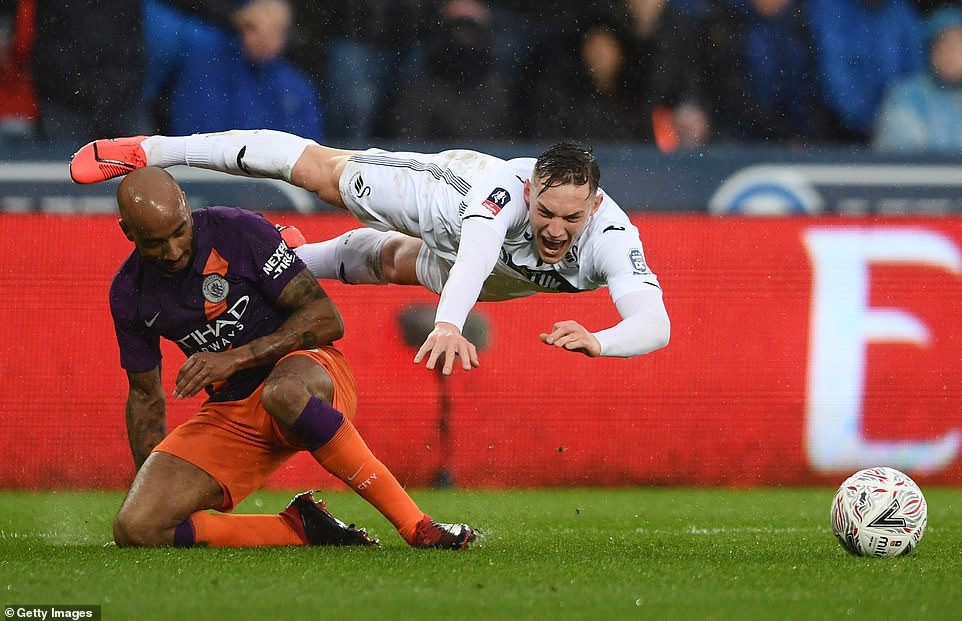 Swansea were given a penalty following Fabian Delph's challenge on Conor Roberts in the penalty area