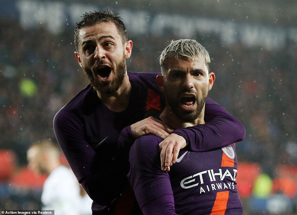 Sergio Aguero celebrates after his late goal saw Manchester City complete their superb comeback against Swansea