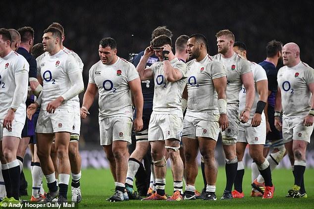 England and Scotland players shake hands following a sensational match at Twickenham