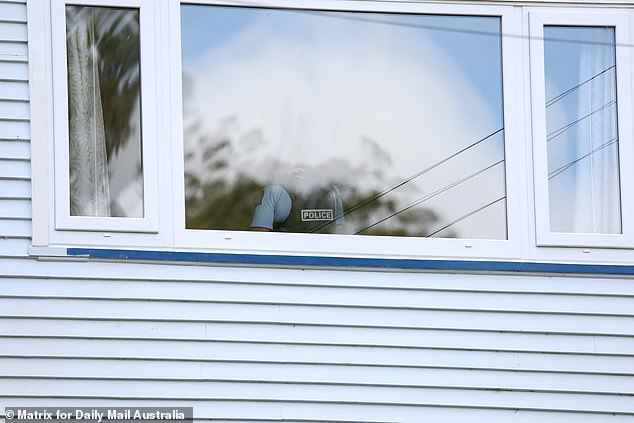 Police remained at the house well into Saturday morning, with one officer telling Daily Mail Australia authorities were guarding the home 24 hours a day to keep the scene secure