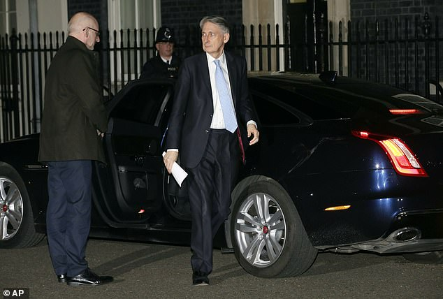 Mr Hammond (seen on March 14) said it was 'absolutely vital' to get Mrs May's deal through in the next week because 'it's the final chance to do this deal without having to have a long extension of the Article 50 period'