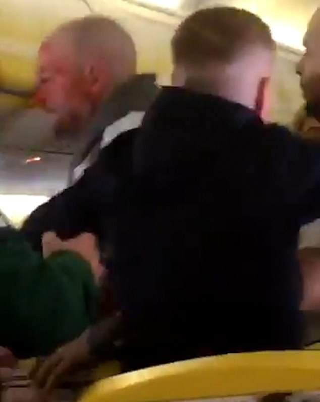 The unnamed man was helped back to his seat by a fellow passenger. Ryanair said he two men who had been fighting were detained when the plane landed