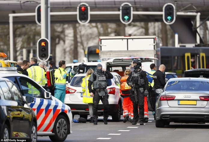 Emergency services stand at the 24 Oktoberplace in Utrecht, the Netherlands, where the shooting took place