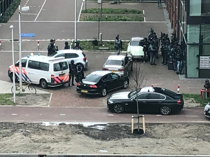 Video footage filmed just hours after the shooting shows heavily armed anti-terror officers in front of an apartment block some 200 yards from the scene the shooting
