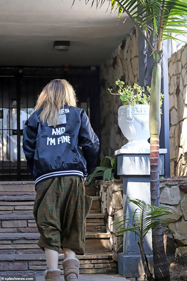 """She's fine: the sources said she was taken to the hospital and brought to a 5150 outlet, but was seen coming home that afternoon, wearing a jacket that said """"I'm fine"""""""