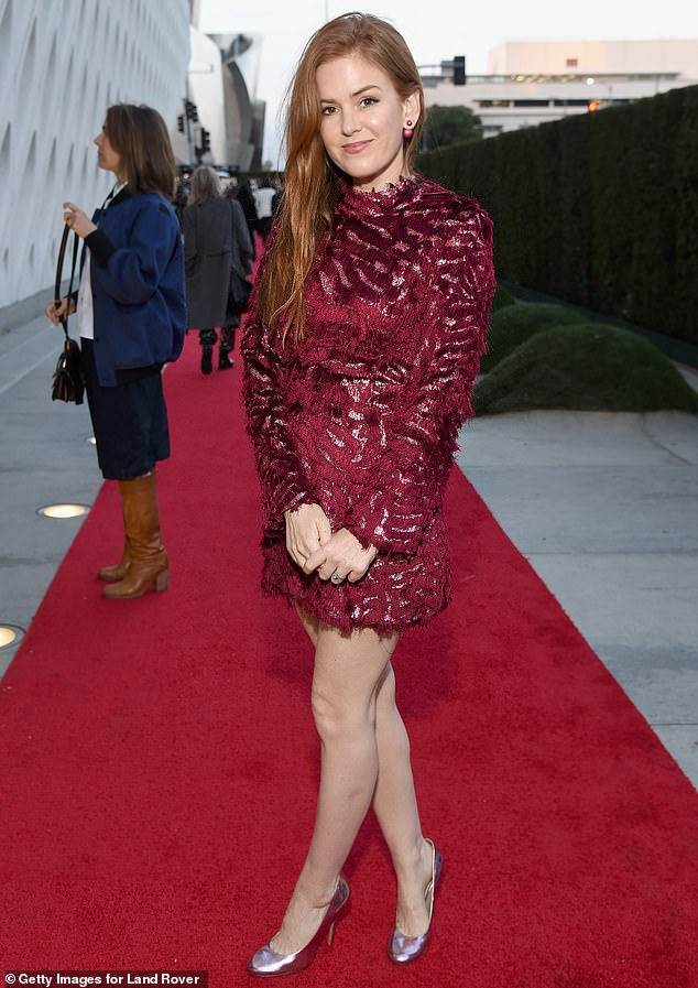 Fiery looks: Tags star Isla Fisher wore an elegant crimson mini dress adorned with red stripes that put her toned legs on display