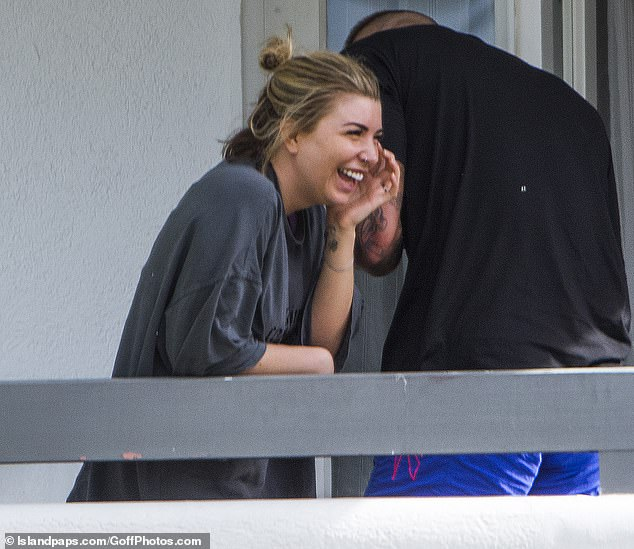 Hilarious: Giggling Olivia wiped tears of laughter from her face as she enjoyed her beau's company during their getaway