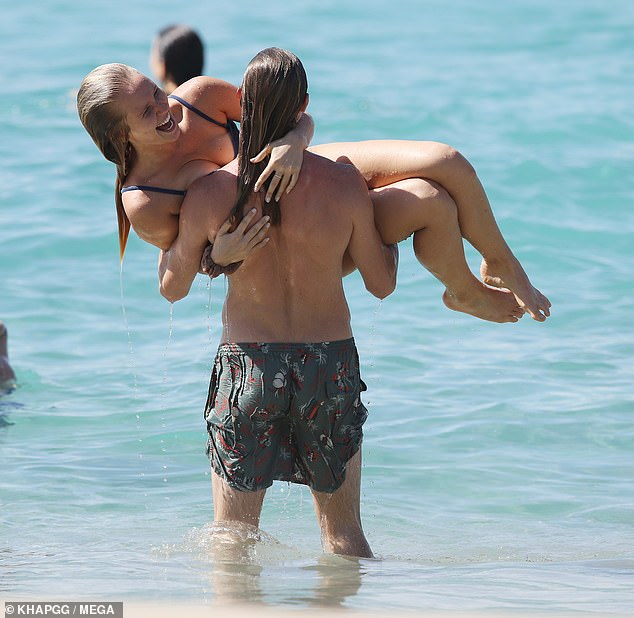 Going strong! Sailor Brinkley-Cook, 20, packed on the PDA with boyfriend Ben Sosne at Sydney's Bondi Beach on Saturday