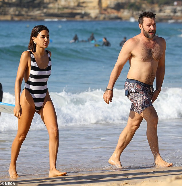 Still going swimmingly! Australian actor Joel Edgerton, 44, and his Vogue fashion director girlfriend, Christine Centenera made a rare appearance as a couple on Saturday morning as they stepped out for a swim at Bondi Beach
