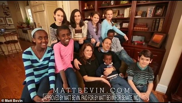 Republican governor Matt Bevin (center) recently made headlines for revealing that he had purposely had all nine of his children (pictured) infected with chickenpox from a neighbor's kid