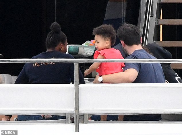 Family day out:While other sweet pictures saw Alexis cuddling their 18-month-old daughter as they had a family day out