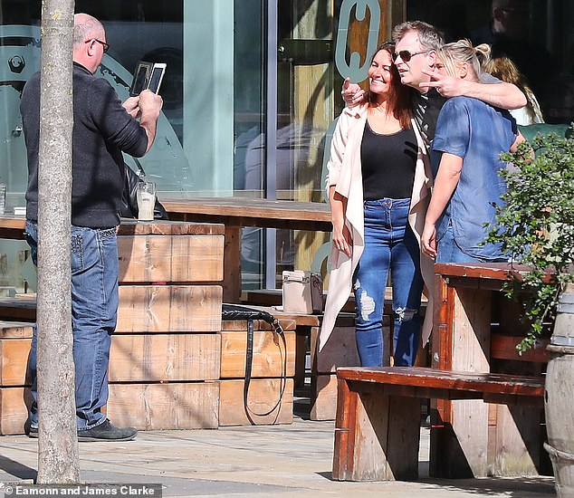 Say cheese: With temperatures steadily rising Gregson looked relaxed in a T-shirt and tinted Aviator sunglasses while posing for a handful of snaps