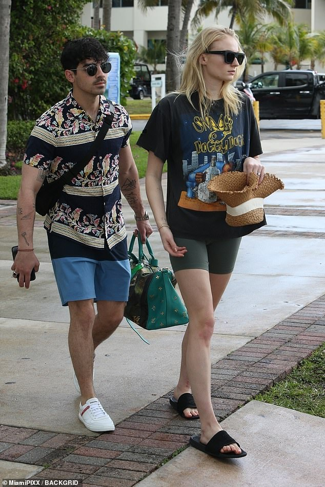 Refreshing break: Earlier that day, the Northampton native enjoyed a scenic stroll around the Florida city with her husband-to-be Joe and his family