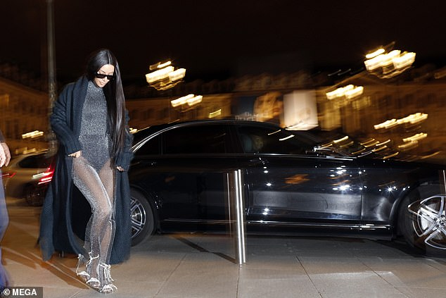 Moving: Kim was impossible to miss in her cramped ensemble when she grabbed the streets of Paris