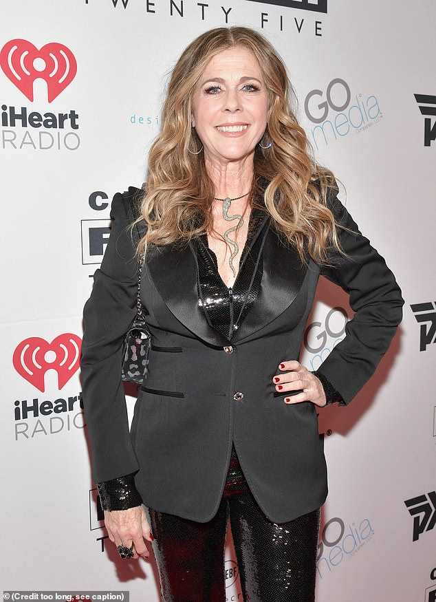 In great shape: Wilson wore a black suit and snake necklace to the Celebrity Fight Night XXV event in Phoenix