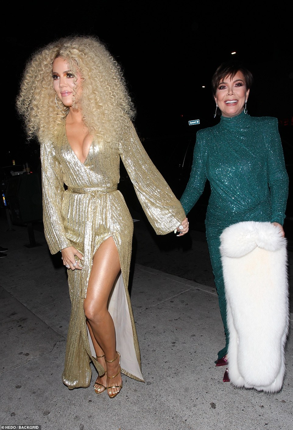 Ready to party: Khloe arrived at the bash hand in hand with her ultra glam mother Kris Jenner, 63, who wowed in green