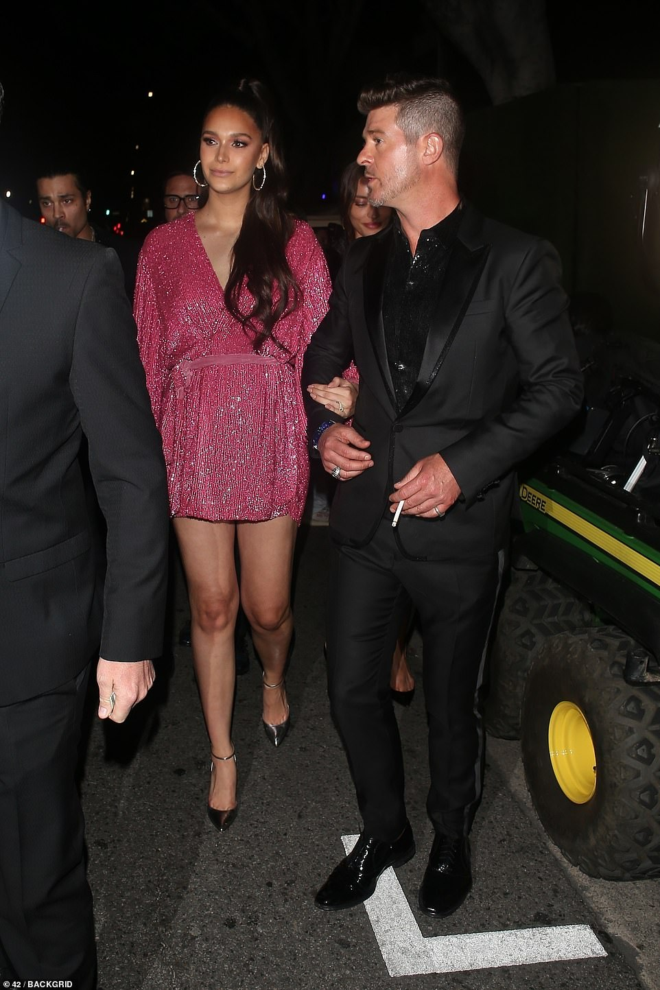 Date night: Another attendee of the party 24-year-old April Love Geary, who arrived with 42-year-old fiance Robin Thicke