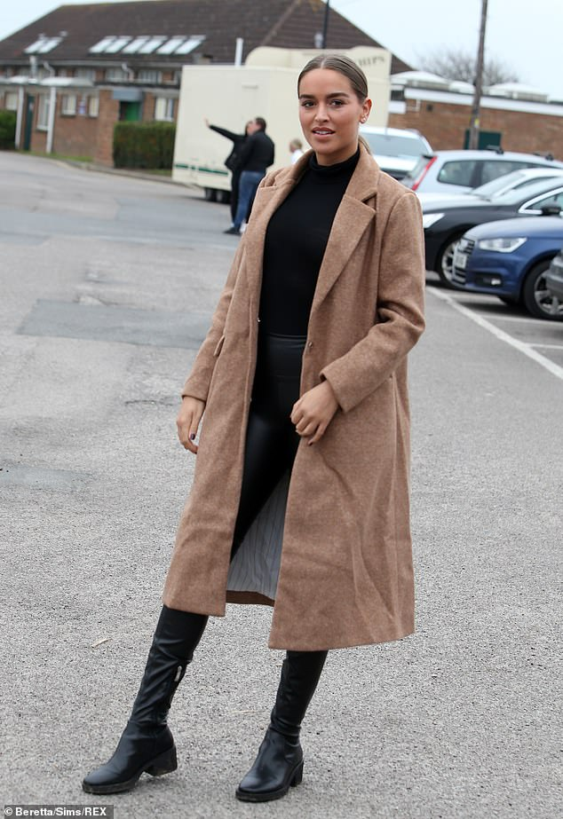 Simple: Fellow newbieChloe Ross opted for a simple look, teaming an oversized brown coat with all-black and knee-high boots