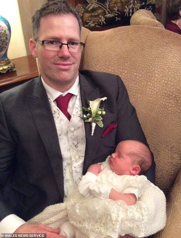 Mrs Smith said: 'Adam saw Evie come into the world because of a reflection on the lamps in surgery and I just waited to hear that cry and burst into happy tears'